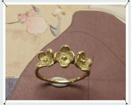 Geelgouden bloemen ring