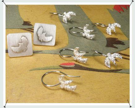 Oorsieraden zilveren ijsvogel en Manchetknopen zilveren ijsvogel