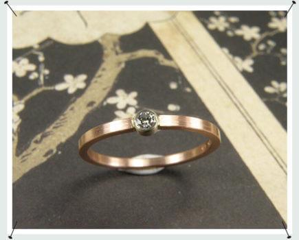 Roodgouden verlovingsring met briljant geslepen diamant