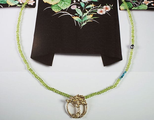 Rosé golden tree pendant on a peridote, apatiet and keshi pearl necklace. Design by Oogst goldsmith.