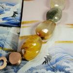 Rutiel kwarts armband met roodgouden kei sluiting. Rutile quartz bracelet with rose gold rock clasp. Oogst goudsmid Amsterdam