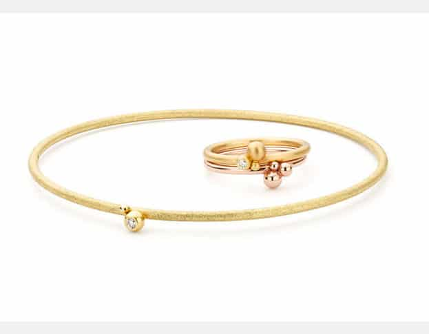 Yellow golden bangle and stack rings from our 'Berries' series.  With playful berries and diamond.s Made by Oogst, goldsmith studio in Amsterdam.