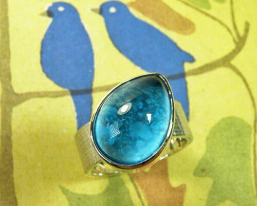Assieraad. Zilveren ring Linnen met topaas. Silver ring Linen with a topaz. Commemorative jewel. Oogst goudsmid Amsterdam