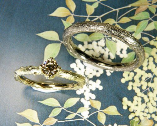 Wedding rings Orchard.Yellow gold twig with diamond and white gold twig. Wedding bands Amsterdam. Oogst goldsmith