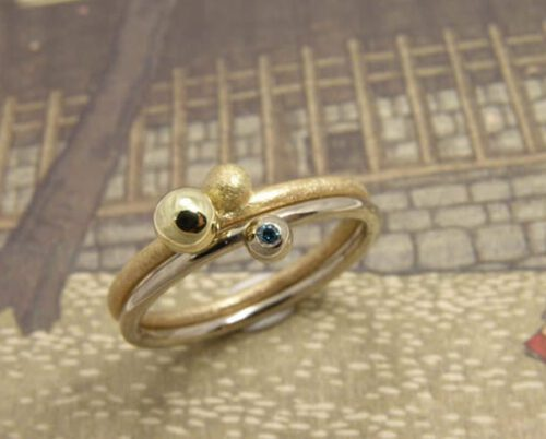 Stack rings Berries. Yellow gold ring. White gold ring with blue diamond. Oogst goldsmith Amsterdam.