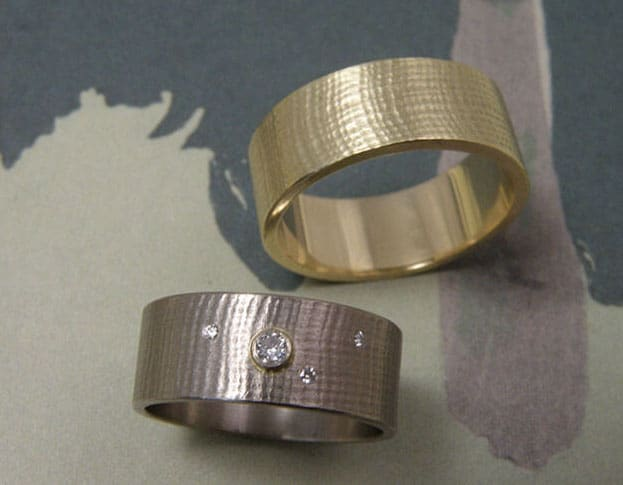 Wedding rings Linen Yellow and white gold rings, with diamonds. Oogst goldsmith Amsterdam.