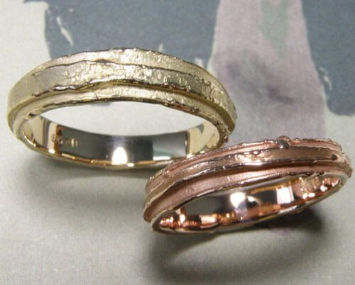 Textured Wedding rings 'Erosion'. Rose golden layered ring. Yellow golden layered ring. Oogst goldsmith Amsterdam.