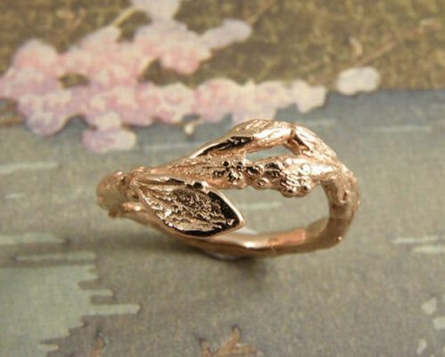 Rose gold ring 'Orchard', playful twig with a leaf. Design by Oogst goldsmith Amsterdam