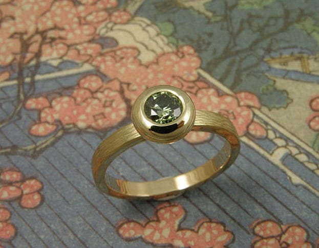 Engagement ring Boletus yellow gold ring with hammering and fancy green diamond. Oogst goldsmith Amsterdam