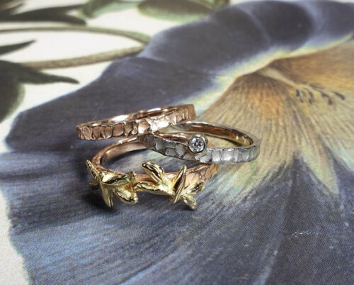 Stack rings Swell and Insects. Rose gold textured ring. White gold ring with diamond. Rose gold ring with yellow gold dragonflies. Goldsmith Amsterdam