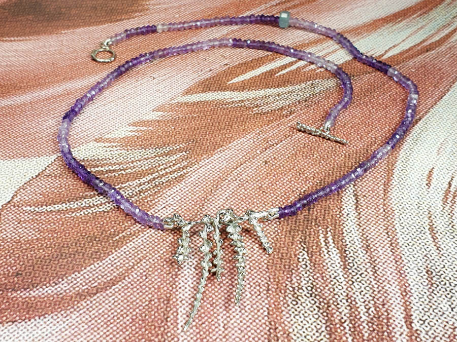 Amethyst necklace with white gold blossom twigs. Design by Oogst goldsmith Amsterdam