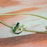 Geelgouden armband met honingraat motief. Yellow gold bracelet with honeycombe motive. Design by Oogst