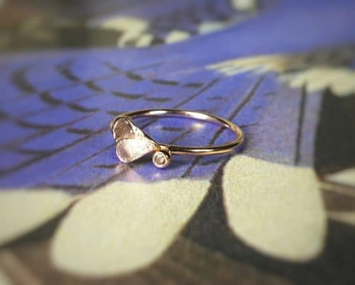 rose gold ring with leaves and a berry with a natural brown brilliant cut diamond