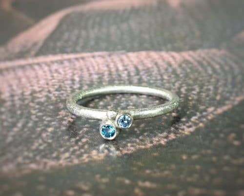 White gold 'Berry' ring with blue diamonds. Oogst goldsmith studio Amsterdam