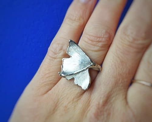 Silver 'Ginkgo' ring. Twig with leaves. Design by Oogst Goldsmith in Amsterdam.