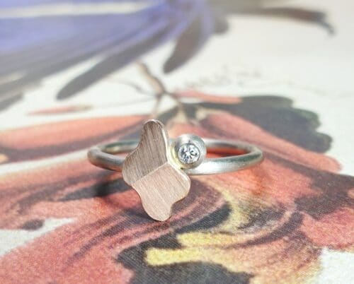White gold ring 'Folding' with rose gold element and a diamond. Design by Oogst goldsmith Amsterdam