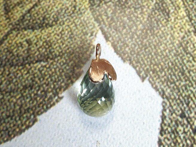Rose gold 'Heart' pendant with a light green briolet cut prasiolite. Oogst goldsmith studio.