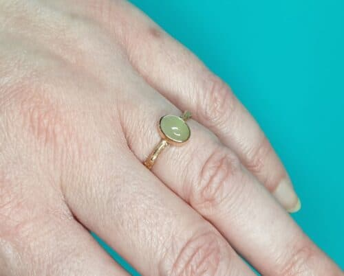 This rose gold 'Orchard' ring is a refined twig with an oval cabochon cut milky green aquamarine. Oogst goldsmith