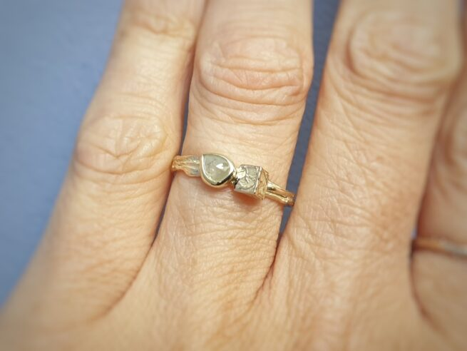 Yellow gold ring 'Twist & Chrystal' with sturdy texture a pear shaped natural diamond. Design by Oogst Jewellery in Amsterdam