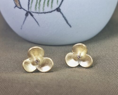 Yellow gold 'In Bloom' ear studs with diamond. Design by Oogst Jewellery in Amsterdam