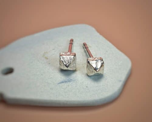 Silver ear studs from the 'Chrystals' series. Design by Oogst Goldsmith in Amsterdam